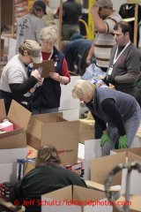 Friday, February 15, 2013.   Volunteers sort and pack an assortment of