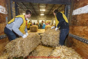 A team of volunteers bag over 1600 bales of straw at Airland Transport for use by the mushers and dogs at the 20+ checkpoints along the trail. Thursday February 12, 2015 prior to Iditarod 2015.(C) Jeff Schultz/SchultzPhoto.com - ALL RIGHTS RESERVEDDUPLICATION PROHIBITED WITHOUT PERMISSION
