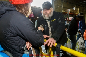 Race Manager Mark Nordman is interviewed for the media as a team of volunteers unload, sort, weigh, tag and palletize thousands of musher food drop bags at Airland Transport warehouse in Anchorage on Wednesday February 18th prior to Iditarod 2015.(C) Jeff Schultz/SchultzPhoto.com - ALL RIGHTS RESERVEDDUPLICATION PROHIBITED WITHOUT PERMISSION