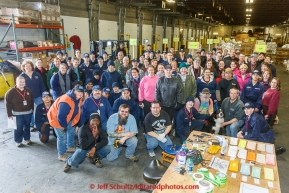 A team of volunteers, including many from the Alaska Military Youth Academy, stop for a group photo during th musher food drop day at Airland Transport warehouse in Anchorage on Wednesday February 18th prior to Iditarod 2015.(C) Jeff Schultz/SchultzPhoto.com - ALL RIGHTS RESERVEDDUPLICATION PROHIBITED WITHOUT PERMISSION