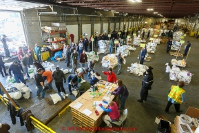 A team of volunteers unload, sort, weigh, tag and palletize thousands of musher food drop bags at Airland Transport warehouse in Anchorage on Wednesday February 18th prior to Iditarod 2015.(C) Jeff Schultz/SchultzPhoto.com - ALL RIGHTS RESERVEDDUPLICATION PROHIBITED WITHOUT PERMISSION