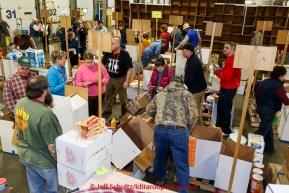 Volunteers sort, stack and box