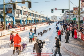 Musher Misha Wiljes runs down 4th avenue during the Ceremonial Start of the 2017 Iditarod in Anchorage on Saturday March 4, 2017 Photo by Jeff Schultz/SchultzPhoto.com  (C) 2017  ALL RIGHTS RESVERVED