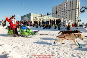 Alan Eischens runs down 4th avenue at the Cordova Street turn during the Ceremonial Start of the 2017 Iditarod in Anchorage on Saturday March 4, 2017Photo by Jeff Schultz/SchultzPhoto.com  (C) 2017  ALL RIGHTS RESVERVED