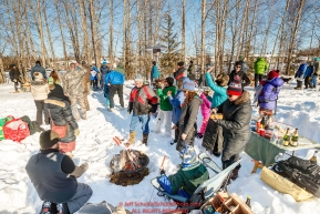 A group calling themselves the IditaRX gang roasts hot dogs for a picnic along the bike/ski trail during the Ceremonial Start of the 2017 Iditarod in Anchorage on Saturday March 4, 2017 Photo by Jeff Schultz/SchultzPhoto.com  (C) 2017  ALL RIGHTS RESVERVED