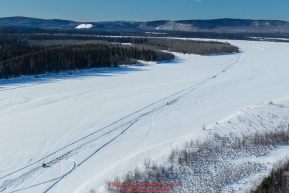 A train of teams run down  the Tanana river between Fairbanks and Nenana during the 2017 Iditarod on Monday March 6, 2017.Photo by Jeff Schultz/SchultzPhoto.com  (C) 2017  ALL RIGHTS RESVERVED