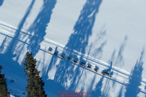A team runs through tree shadows on the trail along the Tanana river between Fairbanks and Nenana during the 2017 Iditarod on Monday March 6, 2017.Photo by Jeff Schultz/SchultzPhoto.com  (C) 2017  ALL RIGHTS RESVERVED