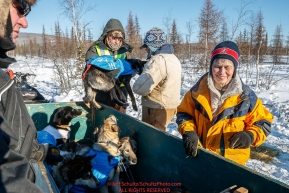 Volunteers load dropped dogs into a trailer to head to the airport for a flight out at the checkpoint in Manley Hot Springs during the 2017 Iditarod on Tuesday March 7, 2017.Photo by Jeff Schultz/SchultzPhoto.com  (C) 2017  ALL RIGHTS RESVERVED