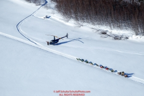 Jeff King passes Iditarod helicopter pilot Bill Kramer as he waits for the Iditarod Insider videographer to film teams on the trail on the Tanana River after leaving the Manley Hot Springs checkpoint during the 2017 Iditarod on Tuesday March 7, 2017.Photo by Jeff Schultz/SchultzPhoto.com  (C) 2017  ALL RIGHTS RESVERVED