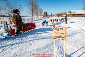 Peter Reuter runs down the road and into the Tanana checkpoint during the 2017 Iditarod on Wednesday afternoon March 8, 2017.Photo by Jeff Schultz/SchultzPhoto.com  (C) 2017  ALL RIGHTS RESERVED