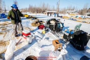 Paul Hansen gets ready to feed dogs at the Tanana checkpoint during the 2017 Iditarod on Wednesday afternoon March 8, 2017.Photo by Jeff Schultz/SchultzPhoto.com  (C) 2017  ALL RIGHTS RESERVED