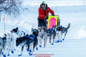Wade Marrs runs up the hill as he arrives in first place at the Ruby checkpoint during the 2017 Iditarod on Wednesday March 8, 2017.Photo by Jeff Schultz/SchultzPhoto.com  (C) 2017  ALL RIGHTS RESERVED