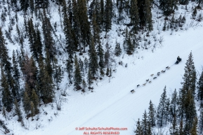 A team runs down a slough on the trail between Nikolai and McGrath during Iditarod 2016.  Alaska.  March 09, 2016.  Photo by Jeff Schultz (C) 2016  ALL RIGHTS RESERVED