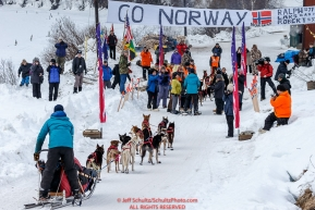 Anna Berington arrives just after her twin sister Kristy to a crowd at the Takotna checkpoint during Iditarod 2016.  Alaska.  March 09, 2016.  Photo by Jeff Schultz (C) 2016  ALL RIGHTS RESERVED
