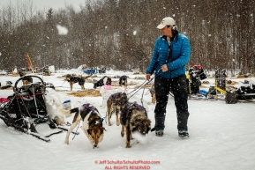 Jessie Royer takes a few dogs for a walk at the Takotna checkpoint while taking a 24-hour layover during Iditarod 2016.  Alaska.  March 09, 2016.  Photo by Jeff Schultz (C) 2016  ALL RIGHTS RESERVED