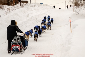 Charley Bejna runs up the hill as he gets to the Ruby checkpoint during the 2017 Iditarod on Thursday March 9, 2017.Photo by Jeff Schultz/SchultzPhoto.com  (C) 2017  ALL RIGHTS RESERVED