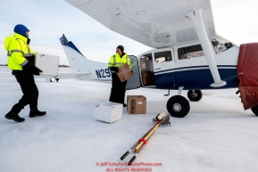 Chief pilot Russ Dunlap (Left) helps volunteer pilot Mike Swalling load his Cessna 206 with supplies headed to Nulato at the Galena airport during the 2017 Iditarod on Thursday afternoon March 9, 2017.Photo by Jeff Schultz/SchultzPhoto.com  (C) 2017  ALL RIGHTS RESERVED
