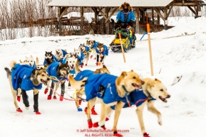 Seth Barnes team rounds a corner as he runs down the road arriving at the Ruby checkpoint during the 2017 Iditarod on Thursday afternoon March 9, 2017.Photo by Jeff Schultz/SchultzPhoto.com  (C) 2017  ALL RIGHTS RESERVED