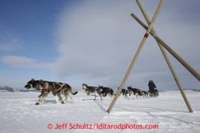 Sonny Lindner passes a race marker as he heads into the Unalakleet checkpoint on Sunday March 10, 2013.Iditarod Sled Dog Race 2013Photo by Jeff Schultz copyright 2013 DO NOT REPRODUCE WITHOUT PERMISSION