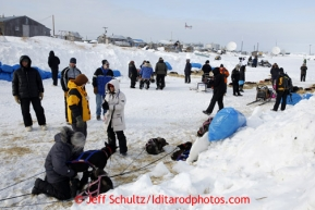 People check out the resting dog teams at the Unalakleet checkpoint on Sunday March 10, 2013.Iditarod Sled Dog Race 2013Photo by Jeff Schultz copyright 2013 DO NOT REPRODUCE WITHOUT PERMISSION