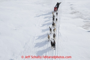 Jeff King runs on the slough shortly after leaving the Unalakleet checkpoint on Sunday March 10, 2013.Iditarod Sled Dog Race 2013Photo by Jeff Schultz copyright 2013 DO NOT REPRODUCE WITHOUT PERMISSION