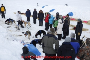 A crowd at the Unalakleet checkpoint gathers to see Martin Buser as he arrived on Sunday March 10, 2013.Iditarod Sled Dog Race 2013Photo by Jeff Schultz copyright 2013 DO NOT REPRODUCE WITHOUT PERMISSION