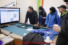 Unalakleet race fans watch the computer screen with musher's GPS positions at the Unalakleet checkpoint on Sunday March 10, 2013.Iditarod Sled Dog Race 2013Photo by Jeff Schultz copyright 2013 DO NOT REPRODUCE WITHOUT PERMISSION