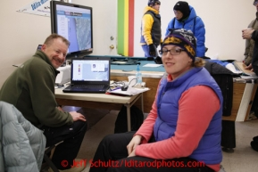Volunteer Comms Al Wilson (L) and Kelly Neuman man the computer and phones at the Unalakleet checkpoint on Sunday March 10, 2013.Iditarod Sled Dog Race 2013Photo by Jeff Schultz copyright 2013 DO NOT REPRODUCE WITHOUT PERMISSION