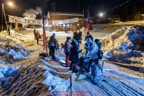 Cody Strathe checks in and out of  the Takotna checkpoint in the early morning on Thursday March 10 during Iditarod 2016.  Alaska.    Photo by Jeff Schultz (C) 2016  ALL RIGHTS RESERVED