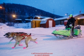 Ryan Redington runs through the Takotna checkpoint in the early morning on Thursday March 10 during Iditarod 2016.  Alaska.    Photo by Jeff Schultz (C) 2016  ALL RIGHTS RESERVED