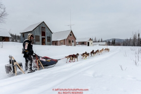 Ed Stielstra runs past old miners cabins on his way to the Ophir Checkpoint on Thursday March 10 during Iditarod 2016.  Alaska.    Photo by Jeff Schultz (C) 2016  ALL RIGHTS RESERVED
