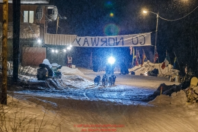 Katherine Keith leaves the Takotna checkpoint in the early morning on Thursday March 10 during Iditarod 2016.  Alaska.    Photo by Jeff Schultz (C) 2016  ALL RIGHTS RESERVED
