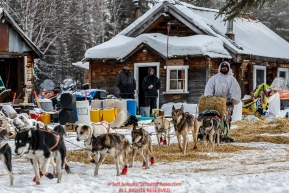 Cim Smyth leaves his parking spot at the Ophir Checkpoint on Thursday March 10 during Iditarod 2016.  Alaska.    Photo by Jeff Schultz (C) 2016  ALL RIGHTS RESERVED
