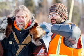 Head Checker Tim Bodony gives directions to Peter Reuter at the Galena checkpoint during the 2017 Iditarod on Friday afternoon March 10, 2017.Photo by Jeff Schultz/SchultzPhoto.com  (C) 2017  ALL RIGHTS RESERVED