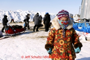 3 year old Melody Jackson watches teams resting at Shaktoolik on Monday March 11, 2013.Iditarod Sled Dog Race 2013Photo by Jeff Schultz copyright 2013 DO NOT REPRODUCE WITHOUT PERMISSION