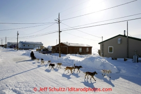 Ramey Smyth runs down the main road and into the Shaktoolik checkpoint on Monday March 11, 2013.Iditarod Sled Dog Race 2013Photo by Jeff Schultz copyright 2013 DO NOT REPRODUCE WITHOUT PERMISSION