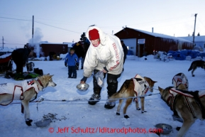 Aily Zirkle feeds her dog team at the Elim checkpoint on Monday March 11, 2013.Iditarod Sled Dog Race 2013Photo by Jeff Schultz copyright 2013 DO NOT REPRODUCE WITHOUT PERMISSION