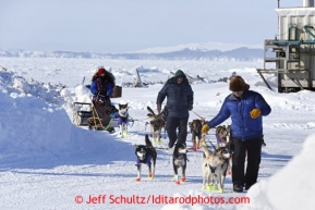 Karin Hendrickoson is helped out of the Shaktoolik checkpoint on Monday March 11, 2013.Iditarod Sled Dog Race 2013Photo by Jeff Schultz copyright 2013 DO NOT REPRODUCE WITHOUT PERMISSION