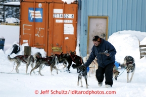 Carl Paul leads Jeff King's team into the Elim checkpoint on Monday March 11, 2013.Iditarod Sled Dog Race 2013Photo by Jeff Schultz copyright 2013 DO NOT REPRODUCE WITHOUT PERMISSION