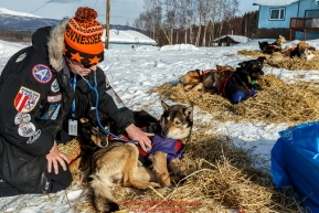 Veterinarian Gayle Tate examines a Kelly Maixner dog at Ruby on Friday March 11th during Iditarod 2016.  Alaska.    Photo by Jeff Schultz (C) 2016  ALL RIGHTS RESERVED