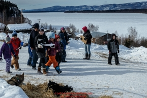 Ruby School children take a field trip for a scavenger hunt and to see the Iditarod dogs along the main street of the village at the Ruby Checkpoint during the 2016 Iditarod.  March 11, 2016   Photo by Jeff Schultz (C) 2016  ALL RIGHTS RESERVED