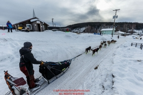 Richile Diehl runs down the road as he leaves the Ruby Checkpoint during the 2016 Iditarod.  March 11, 2016    Photo by Jeff Schultz (C) 2016  ALL RIGHTS RESERVED
