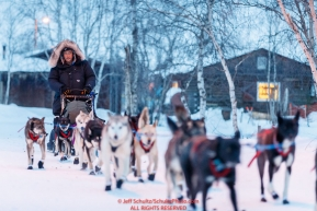 John Baker runs down the road as he leaves the Huslia checkpoint during the 2017 Iditarod on Saturday morning March 11, 2017.Photo by Jeff Schultz/SchultzPhoto.com  (C) 2017  ALL RIGHTS RESERVED