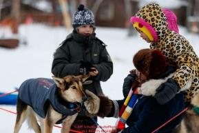 Local school children pet a Ryan Redington dog