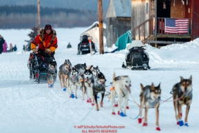 Mitch Seavey runs down the road to arrive first into the Kaltag checkpoint during the 2017 Iditarod on Saturday afternoon March 11, 2017.Photo by Jeff Schultz/SchultzPhoto.com  (C) 2017  ALL RIGHTS RESERVED