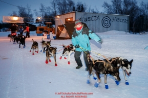 Volunteer Sally Hamm helps guide Lars Monsen dogs as he  checks in at the Huslia checkpoint during the 2017 Iditarod on Saturday morning March 11, 2017.Photo by Jeff Schultz/SchultzPhoto.com  (C) 2017  ALL RIGHTS RESERVED
