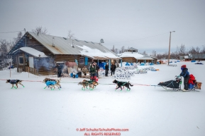 Ryan Redington runs past the Tribal Council building as he leaves  the Huslia checkpoint during the 2017 Iditarod on Saturday morning March 11, 2017.Photo by Jeff Schultz/SchultzPhoto.com  (C) 2017  ALL RIGHTS RESERVED