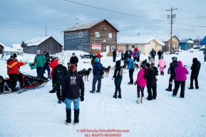 Mitch Seavey checks in as he arrives first into the Kaltag checkpoint to claim the Bristol Bay Native Corporation