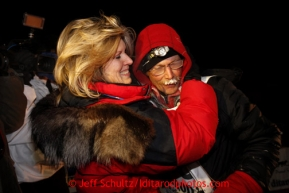 Mitch Seavey, right, 53, gets a hug and kiss from his wife, Janine, after pulling into Nome first and winning his second Iditarod sled dog race on Tuesday March 12, 2013. Seavey made the journey from Willow in 9 days, 7 hours, 39 minutes, 56 seconds. Iditarod Sled Dog Race 2013Photo by Jeff Schultz copyright 2013 DO NOT REPRODUCE WITHOUT PERMISSION