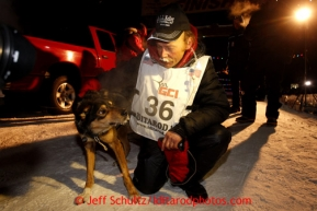 Mitch Seavey, right, 53, pets one of his lead dogs, Tanner, after pulling into Nome first and winning his second Iditarod sled dog race on Tuesday March 12, 2013. Seavey made the journey from Willow in 9 days, 7 hours, 39 minutes, 56 seconds. Iditarod Sled Dog Race 2013Photo by Jeff Schultz copyright 2013 DO NOT REPRODUCE WITHOUT PERMISSION